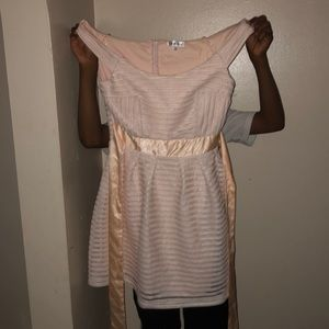 I'm selling this light pink and white dress